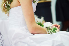 Young bride with flower decorations on her wristle Stock Photography