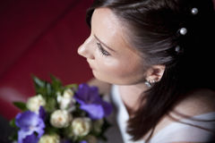 Young bride with flowers. Posing Stock Photo