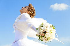 Young bride with flowers Royalty Free Stock Images