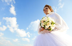 Young bride with flowers Stock Images