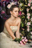 Young bride with flowers in her hair Stock Photo