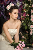 Young bride with flowers in her hair Stock Photos