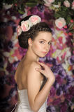 Young bride with flowers in her hair Royalty Free Stock Photo