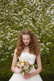 Young bride with flowers Stock Photography