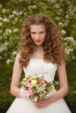 Young bride with flowers Stock Image