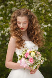 Young bride with flowers Stock Photos