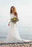 Young bride with flowers Royalty Free Stock Photography