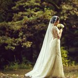 Young bride in forest stock photography