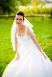 Young bride in garden Royalty Free Stock Photos