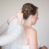 Young bride getting dressed for wedding Royalty Free Stock Photo