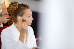 Young bride getting her hair done Royalty Free Stock Photography