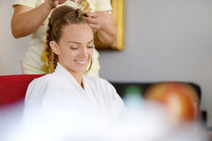 Young bride getting her hair done Stock Image