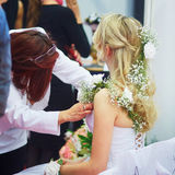 Young bride getting her hair done before wedding Stock Image
