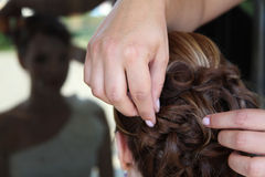 Young bride getting her hair done before wedding Royalty Free Stock Photo