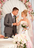 Young bride giving chocolate candy to groom Stock Photo