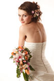 Young bride glanses over her shoulder stock photography