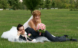 Young  Bride And Groom. Posing together Stock Photo