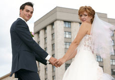 Young  Bride And Groom. Posing together Royalty Free Stock Photos