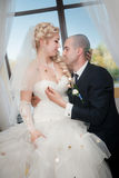 Young bride and groom in banqueting hall Royalty Free Stock Photo