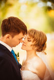 Young bride and groom on the bluer background royalty free stock photos
