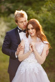 Young Bride and Groom couple in a blooming garden. Stock Photo
