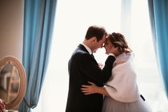 Young bride and groom couple in a bright studio photo Royalty Free Stock Photos