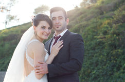 Young bride and groom couple happy outdoors Royalty Free Stock Photo