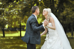 Young bride and groom dancing together Royalty Free Stock Photography