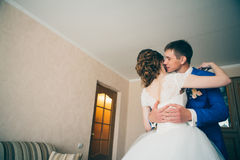 Young bride and groom embracing in the background at home Stock Photo
