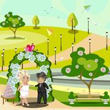 Young bride and groom in a forest under a decorated arch Royalty Free Stock Images