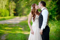 Young bride and groom hugging Royalty Free Stock Photography