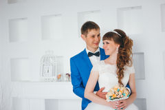 Young bride and groom in interior design studio Royalty Free Stock Photos