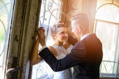 Young Bride and Groom kissing Stock Photos