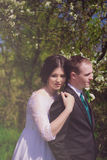 Young bride and groom in a lush garden in the spring Stock Image
