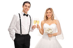 Young bride and groom making a toast Royalty Free Stock Photos