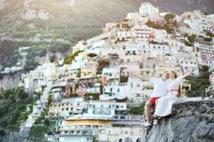 Young bride and groom relaxing and smiling after wedding in Positano, Italy Stock Photography