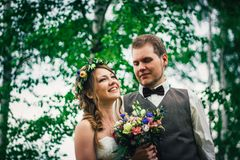 Young bride and groom in the style of provence royalty free stock image