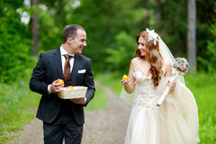 Young bride and groom taking a walk Stock Photography