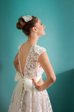 Young bride with hands on hips. Young bride in wedding dress smug satisfied and happy Royalty Free Stock Photos