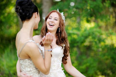 Young bride and her bridesmaid hugging Royalty Free Stock Photos