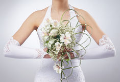 A young bride holding a beautiful bouquet of flowers Royalty Free Stock Photo