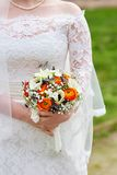 Young bride holding beautiful wedding bouquet Royalty Free Stock Photo