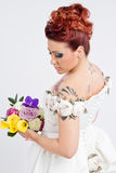 Young bride holding bouquet stock photography