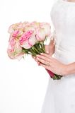Young bride holding a bouquet. On isolated white background with gold wedding ring Stock Photo