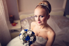Young bride holding bouquet close up portrait near window.  Royalty Free Stock Images