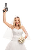 Young bride holding a gun Royalty Free Stock Image
