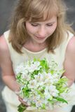 Young bride holding in her hands wedding flowers Royalty Free Stock Images
