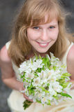 Young bride holding in her hands wedding flowers Stock Image
