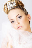 Young bride holding a veil. Young beautiful bride holding a veil Royalty Free Stock Images
