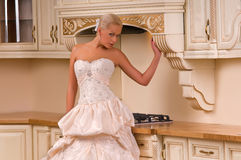 Young bride in the kitchen Royalty Free Stock Images